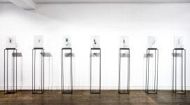 I guardiani, 2013-2015, lampblak, pigments, iron, glass, 182,5x30x14 each